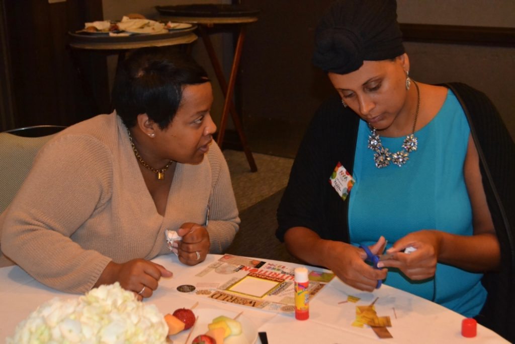 Participants at the Motivated Mom's tour creating vision boards.