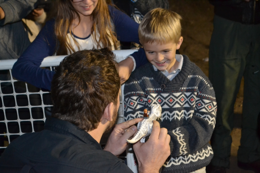 Pratt enjoys chatting with young fan about toys. Photo credit: Gwen Pierce