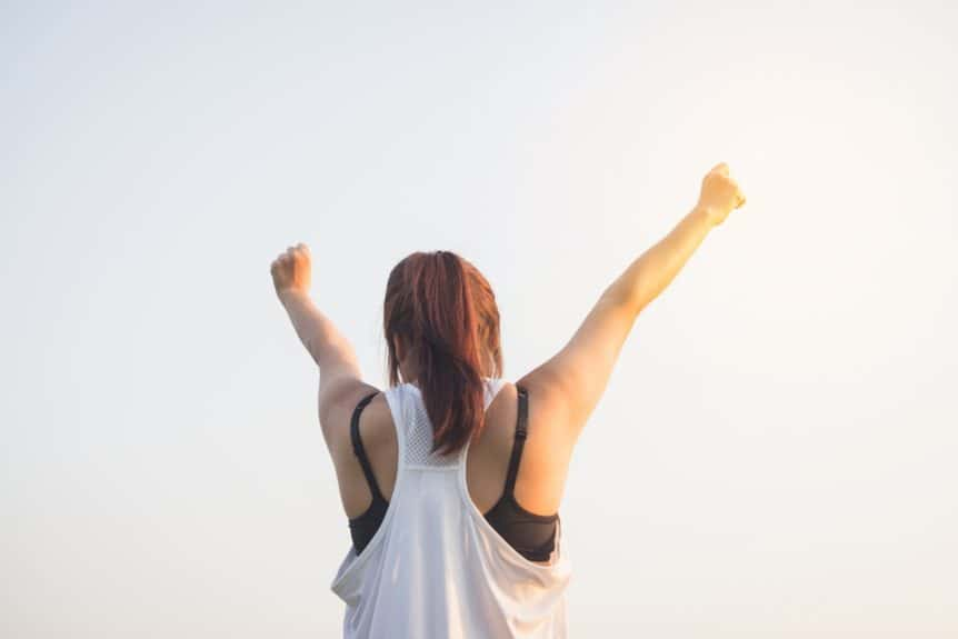 Woman raising arms in victory