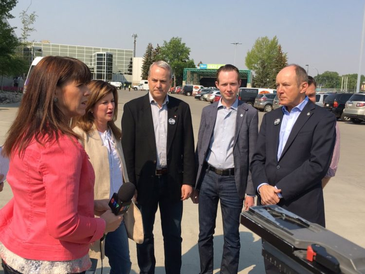 Kerry Diotte with Conservative colleagues and CPC Interim Leader Rona Ambrose touring Northlands relief welcome centre