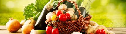Basket of colorful veggies overflowing on a wooden table