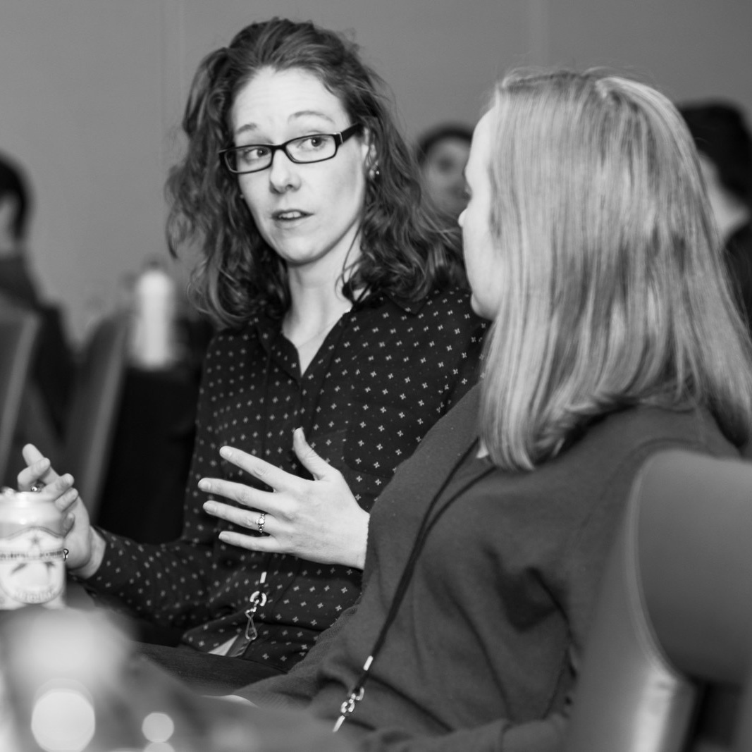 Two women talking black and white