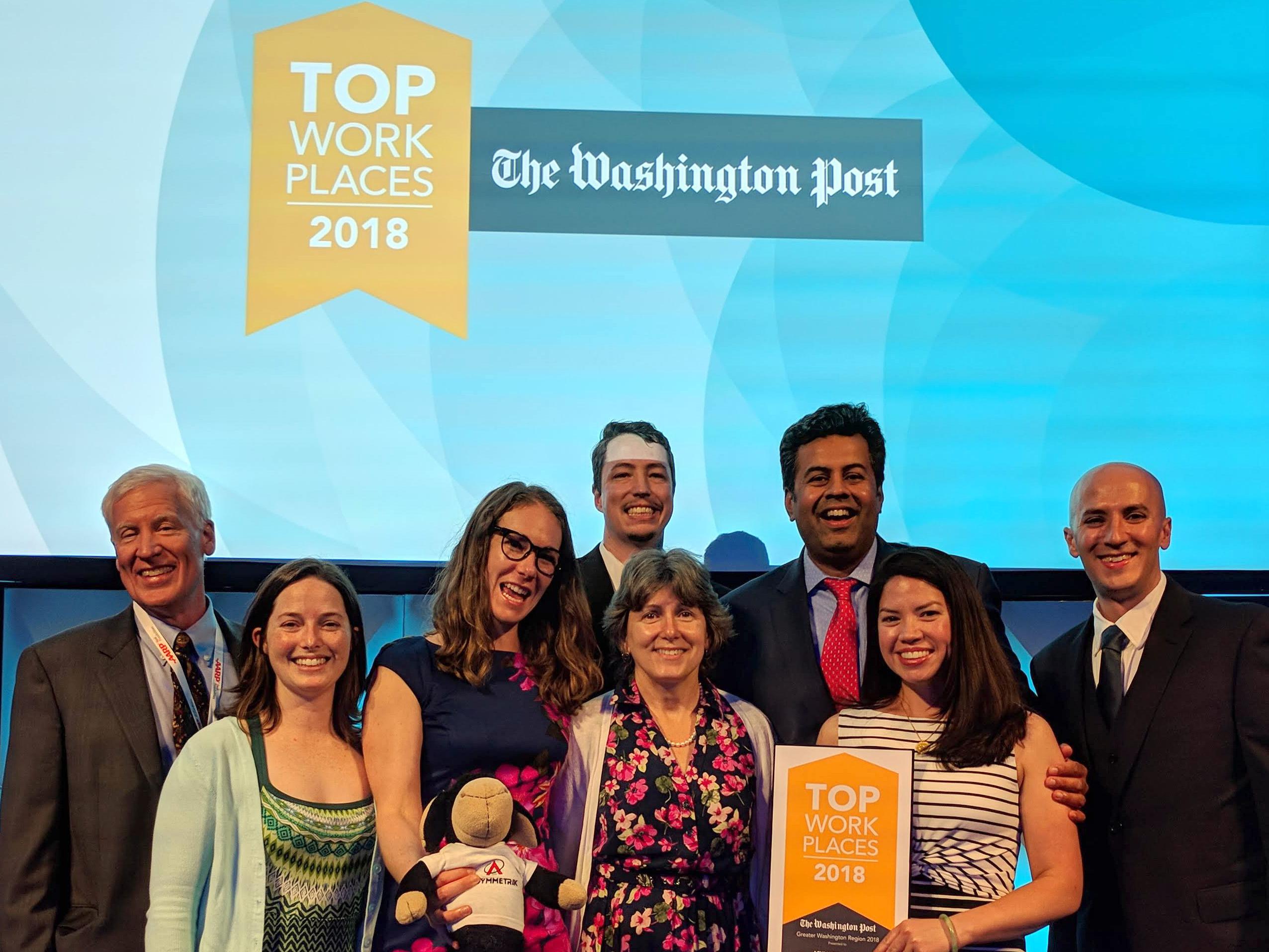 Asymmetrik accepts Washington Post Top Workplace 2018 Award