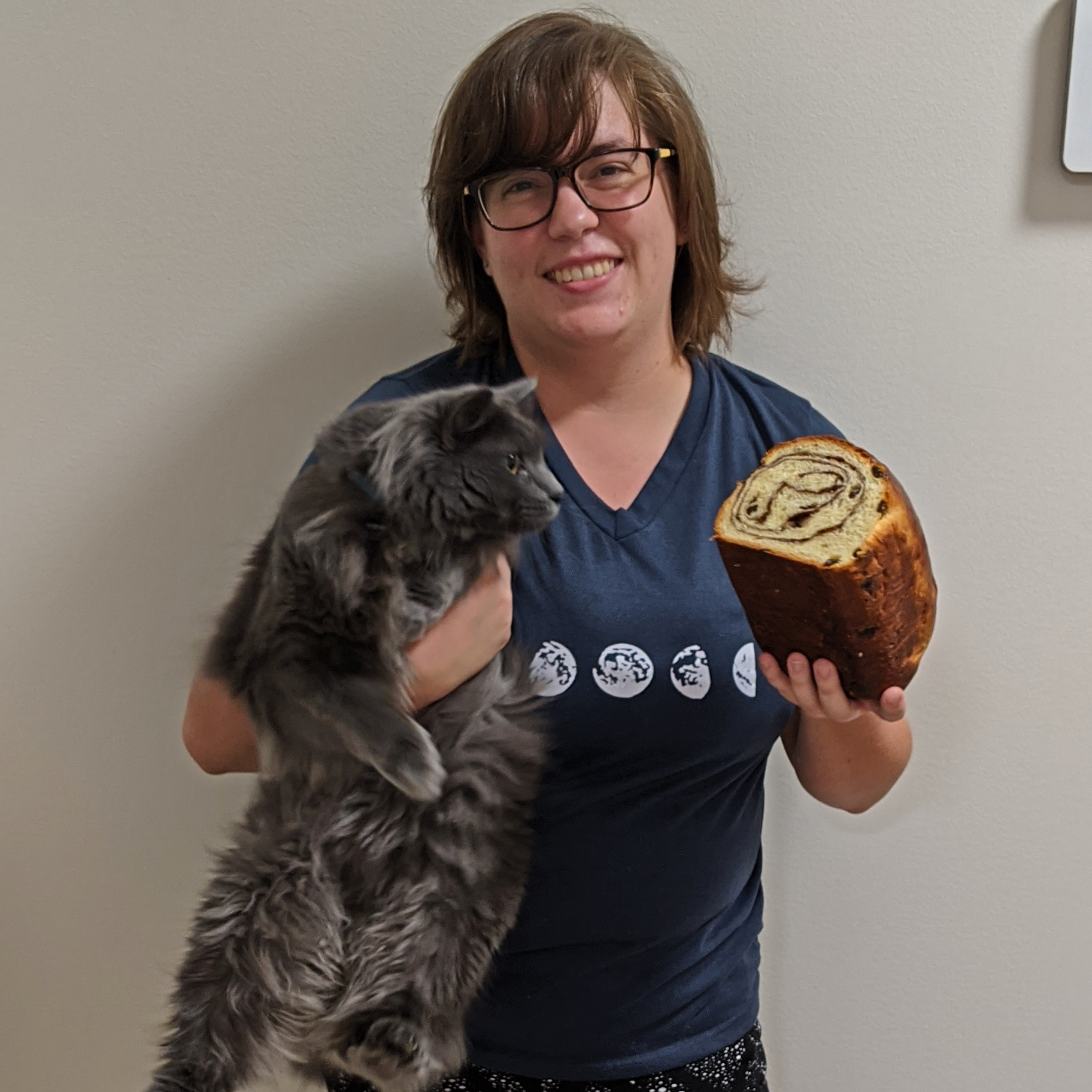 Gina Phipps holding loaf of bread and cat