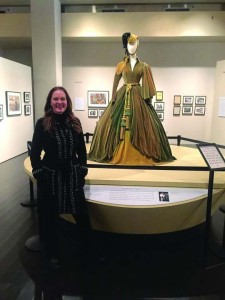 """Harrell stands next to the original green velvet curtain dress at the exhibit recently held in Austin for the 75th anniversary of """"Gone with the Wind."""""""