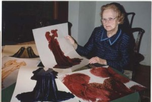 """Sr. Joyce reviews photos of the actual gowns worn in """"Gone with the Wind."""" She had the photos enlarged for reference."""
