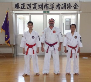 Swart with the Doshu - Grandmaster of Kenseido Aikzuki Takayoshi and his son Akizuki Shogo at the Kenshukai in Japan where Swart achieved seventh-degree, master-level rank in kenseido.