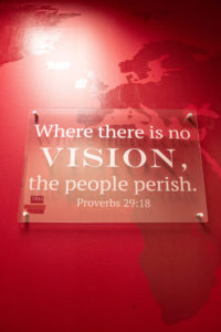 "Mission Wall sign reads ""Where there is no vision, the people perish,"" from Proverbs 29:18."