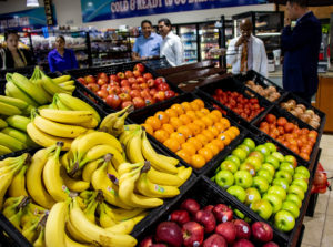 Red Rooster Food Mart filled bins with fresh fruits and vegetables distributed by River City Produce.