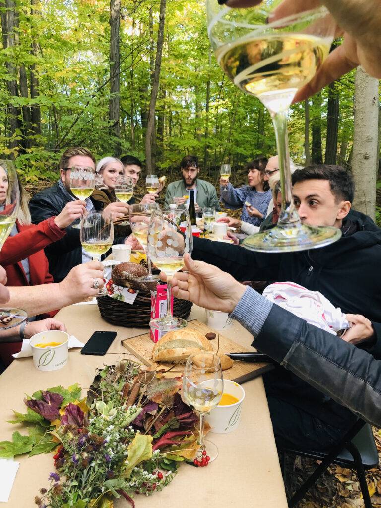 Outdoor dinner with forest themed table arrangement