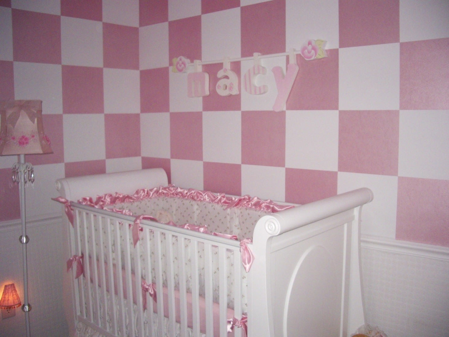 Macy's Nursery is painted in pearlized pink checkerboard