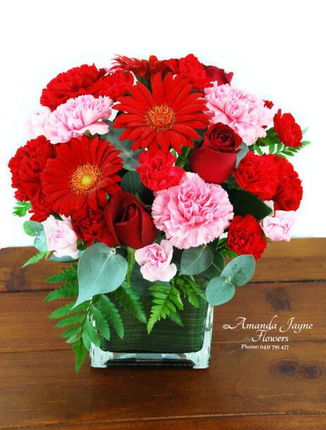 Ruby vase flower arrangement