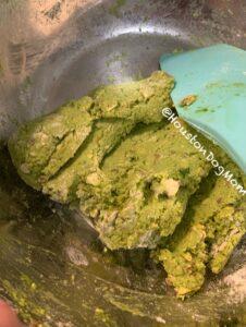 green dough for homemade dog treats with spatula