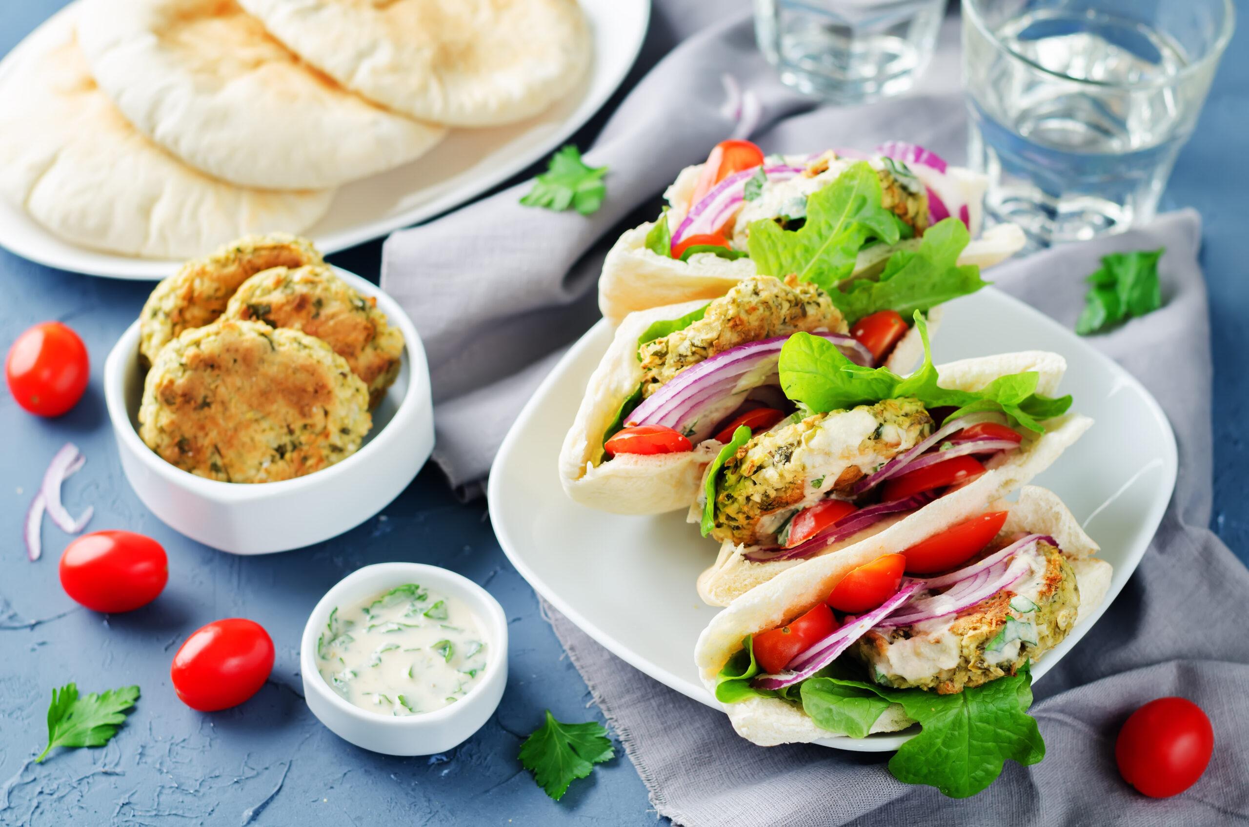 Baked Falafel vegetables lemon Tahini sauce Pita sandwich