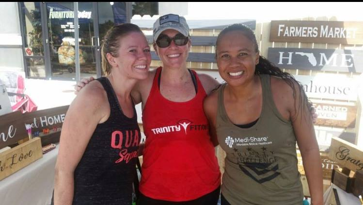 Group of trinity fitness members at a farmers market