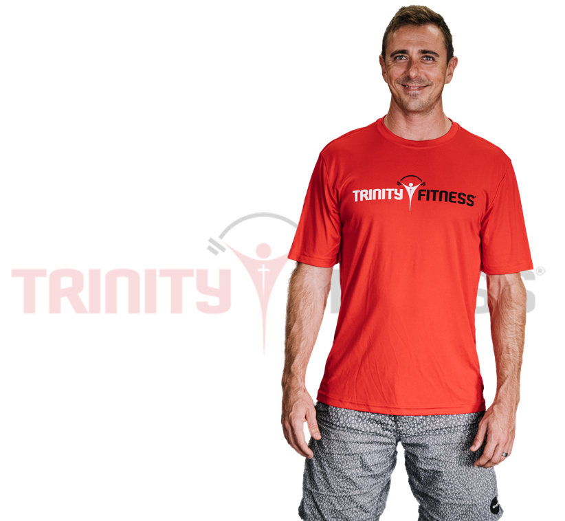 Rylan McCart Trinity Fitness Area Director over the trinity fitness logo on a banner