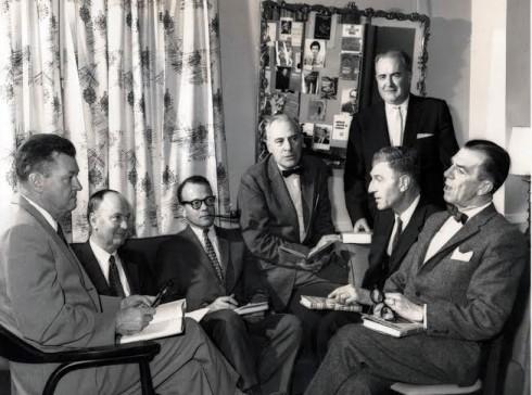 Norman Berg (left) at Macmillan meeting