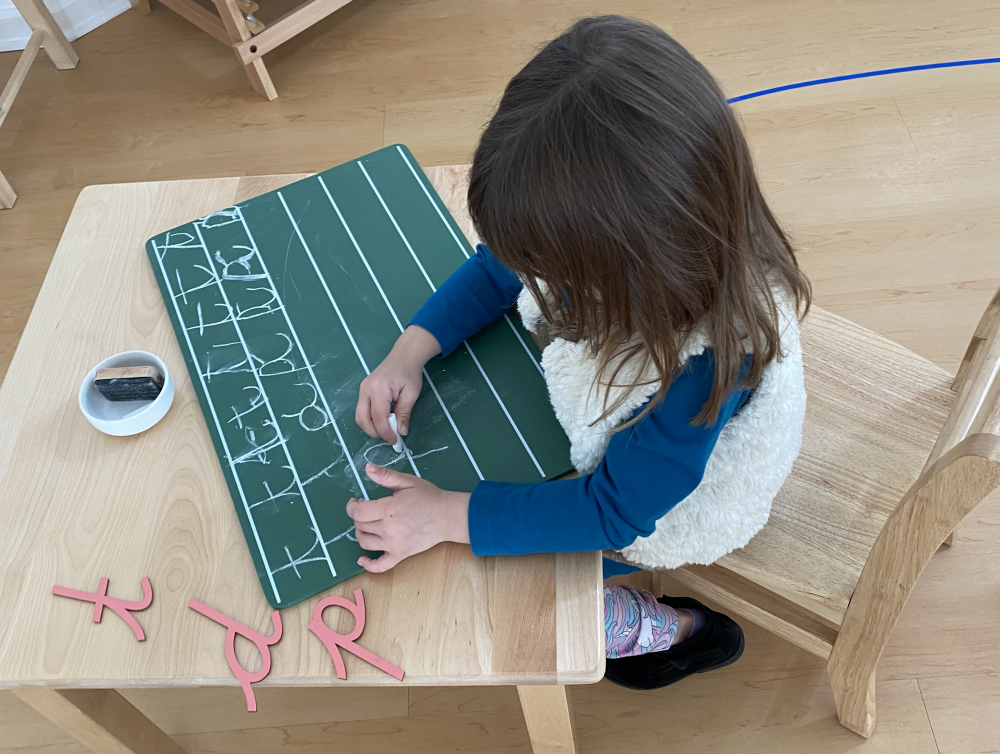 Toddler in Montessori Preschool learning cursive