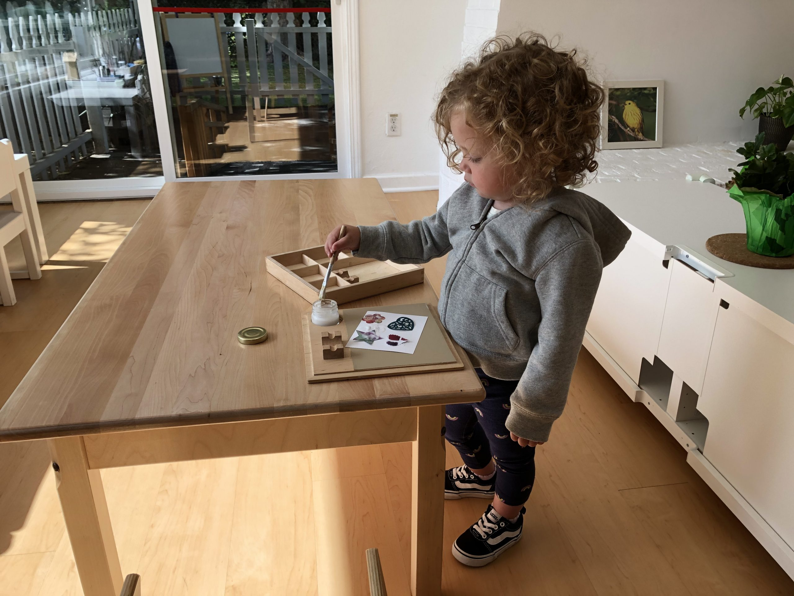 Toddler in a Montessori classroom doing Art