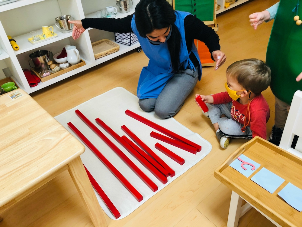 Boy learning math with Teacher guidance at La Jolla Montessori School.jpg
