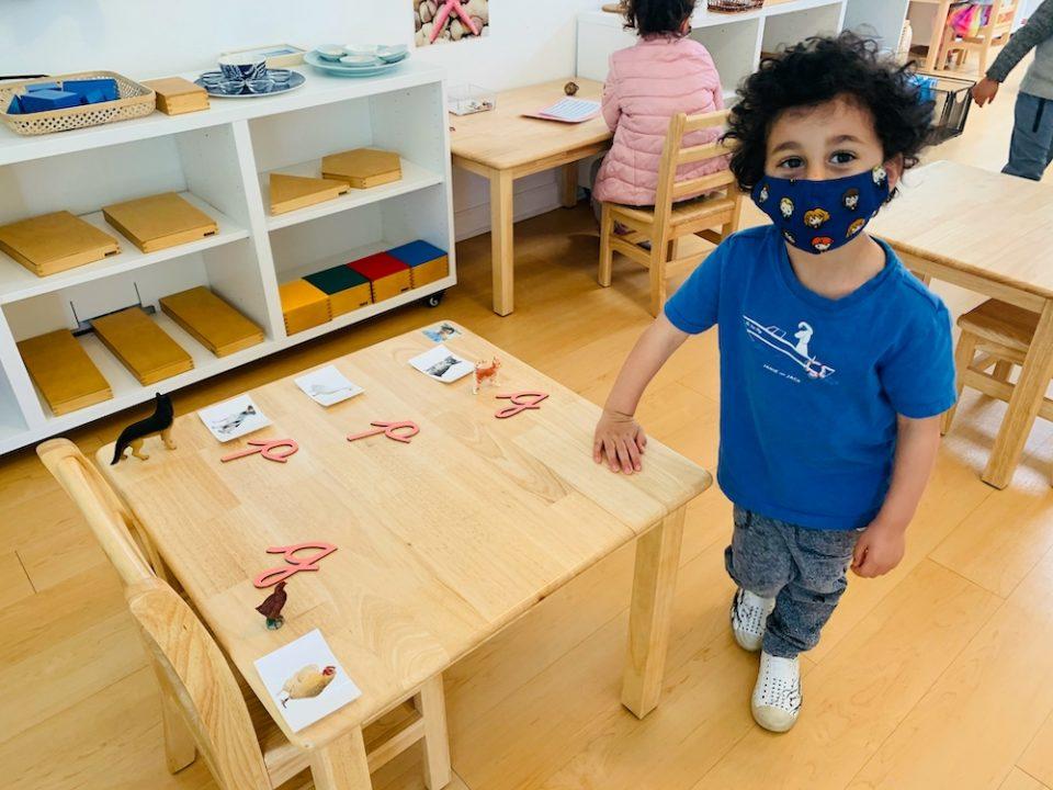 Child at La Jolla Montessori school learning to read and write in spanish