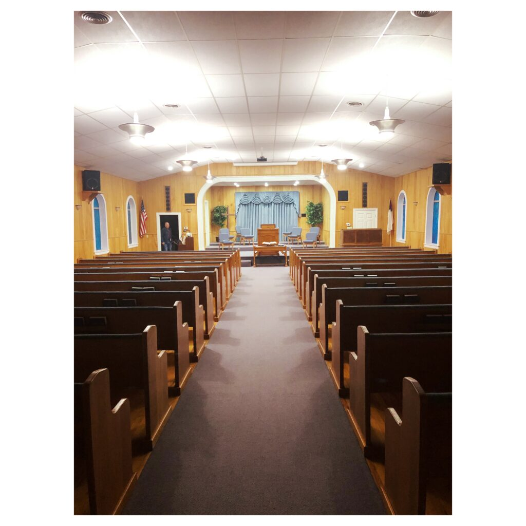 Empty church pews at Woodrow Baptist Church Lubbock Texas