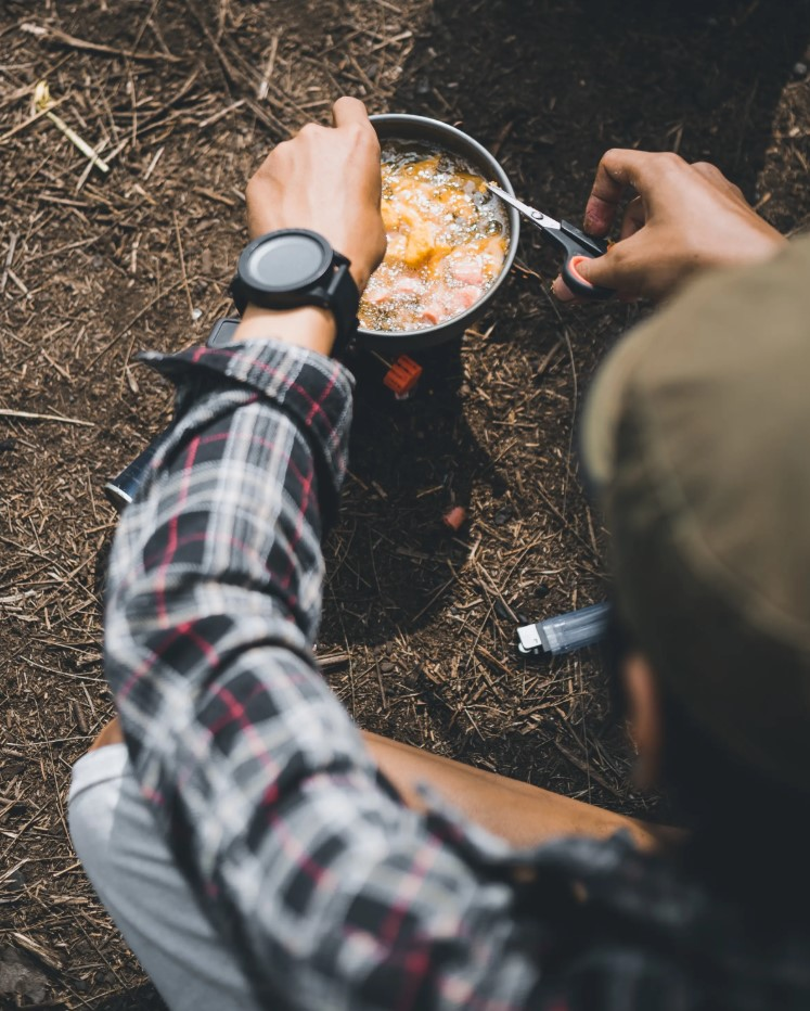 cooking in outdoors while glamping