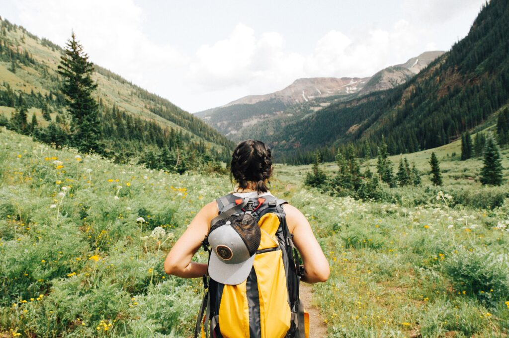 girl with a camping backpack