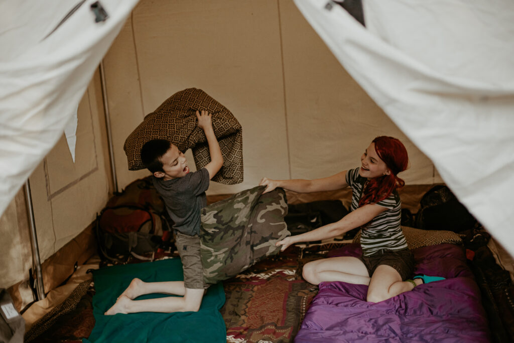 kids playing in wall tent