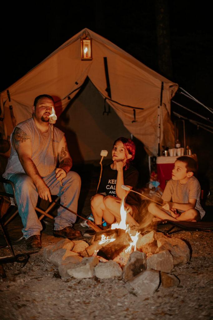 kids having camp fire near a tent