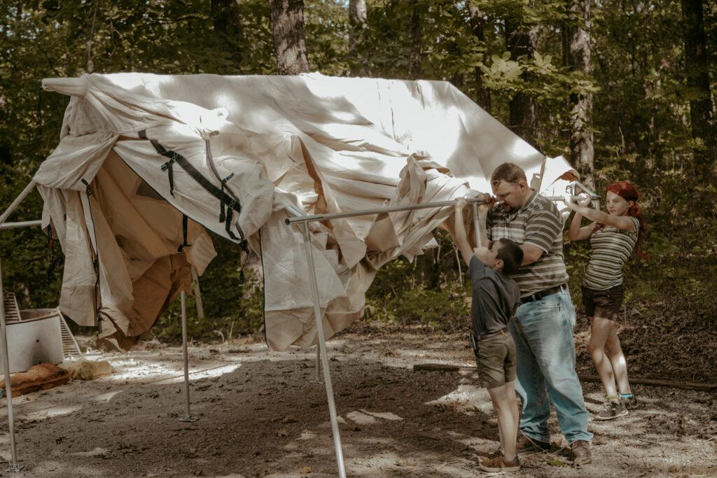 kids preparing a camping tent