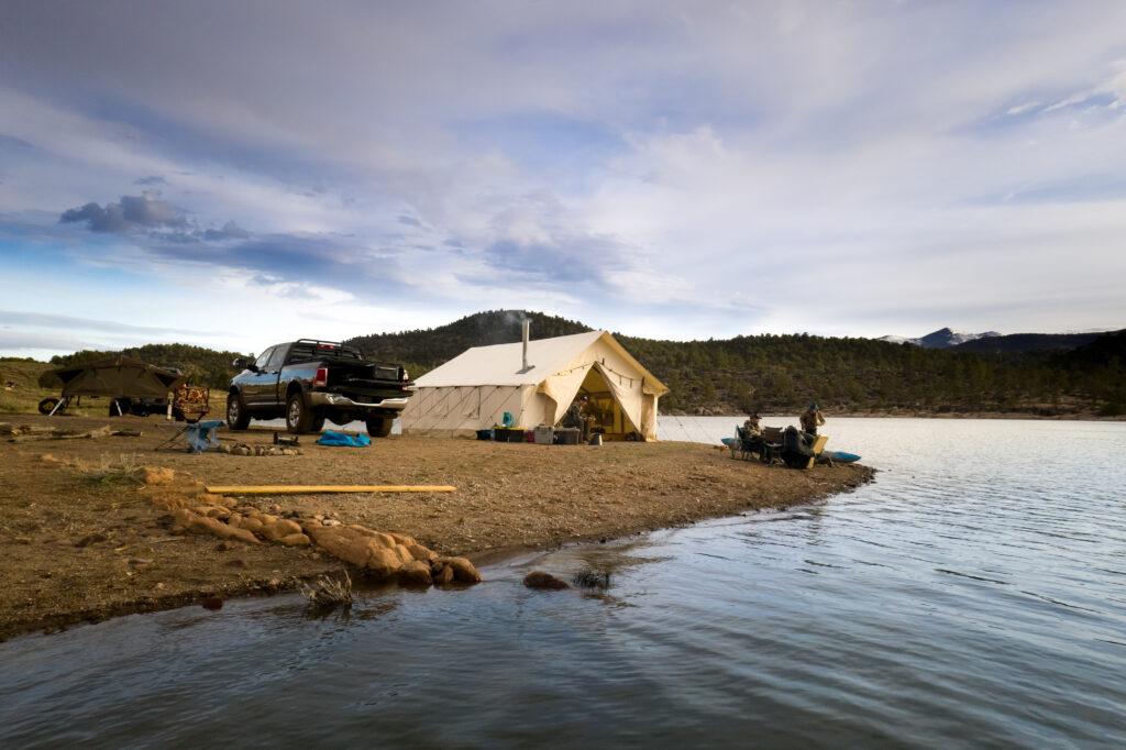 wall tent near a lake
