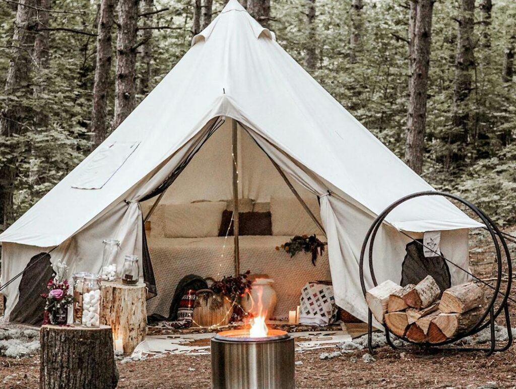 glamping tent outdoors firewood campfire bell tent
