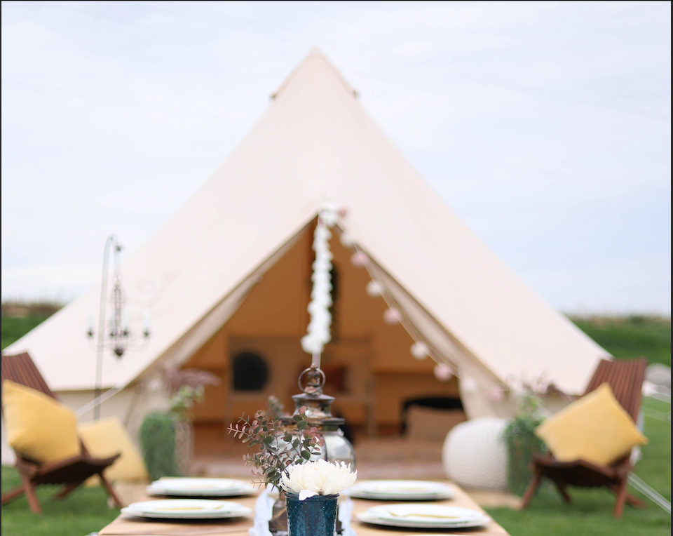 glamping tent outdoors canvas tent dining wine tasting
