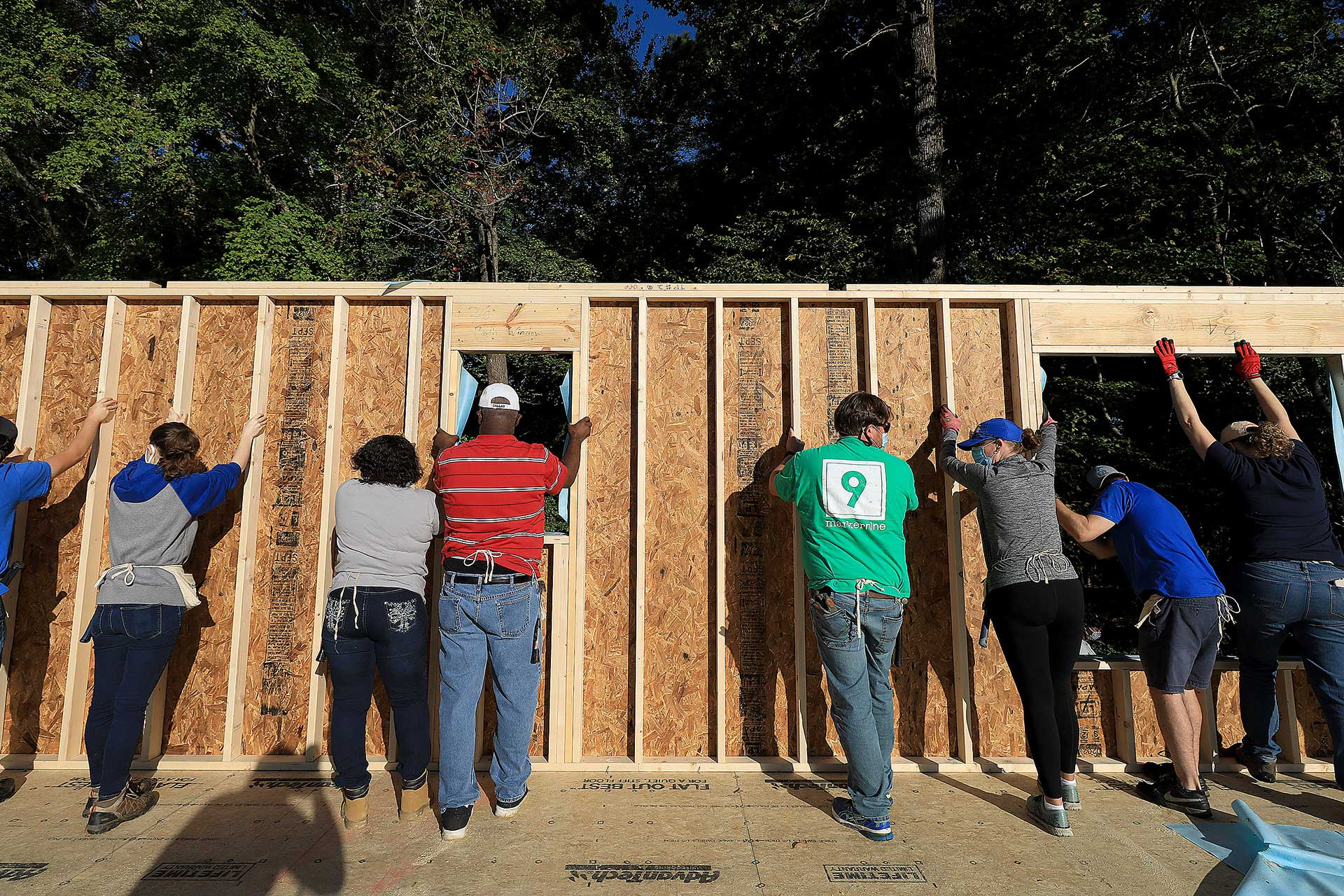 Volunteers help at a Habitat for Humanity home
