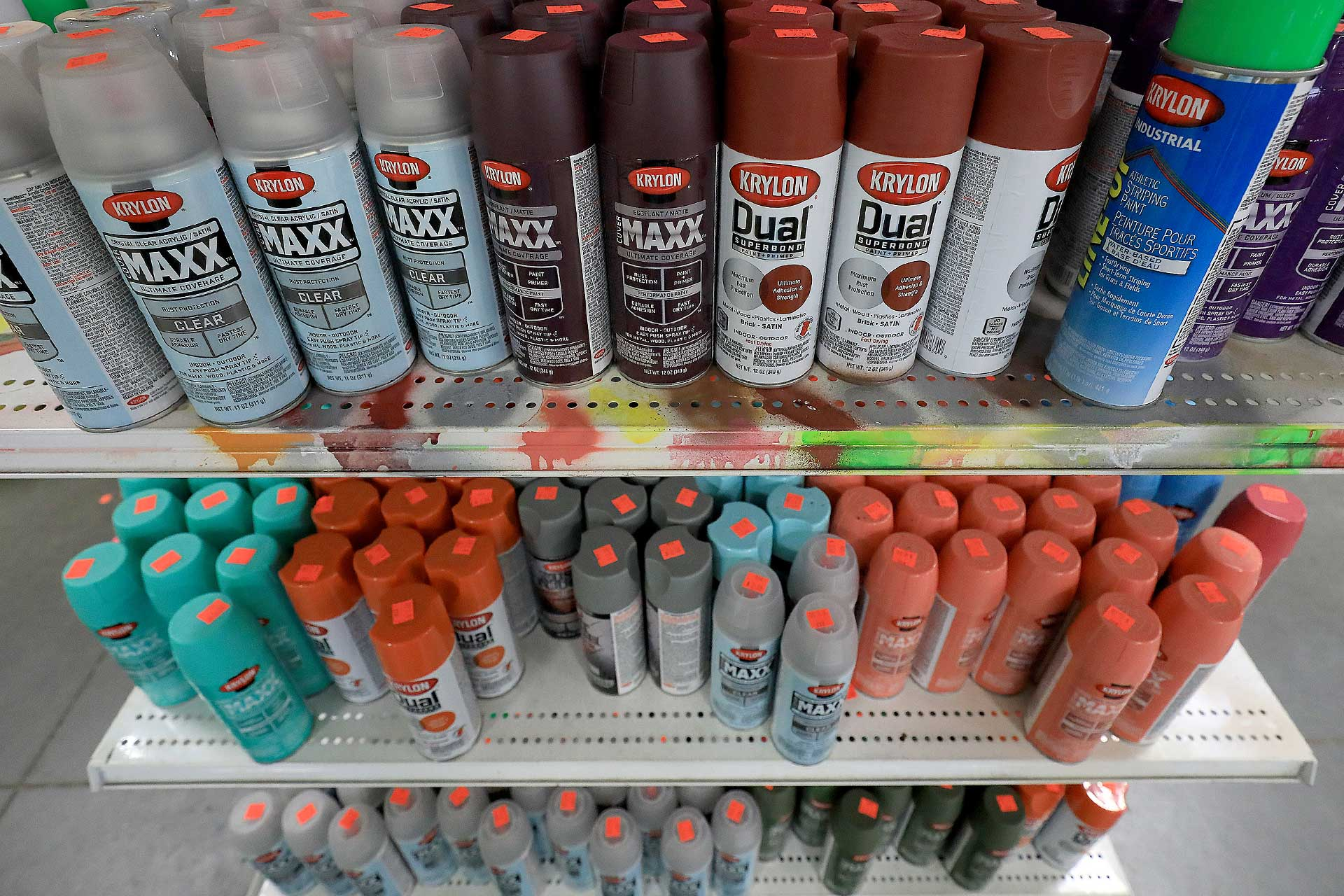 Assorted spray paint cans on sale at the Newport News ReStore