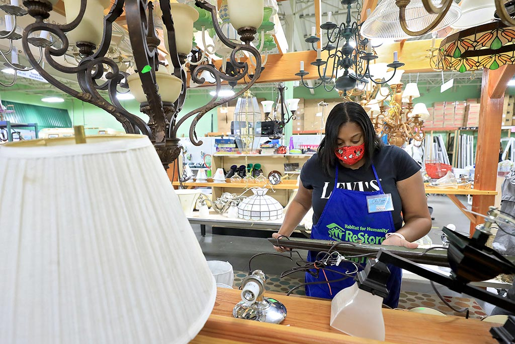 Future Habitat home owner works in the Newport News ReStore