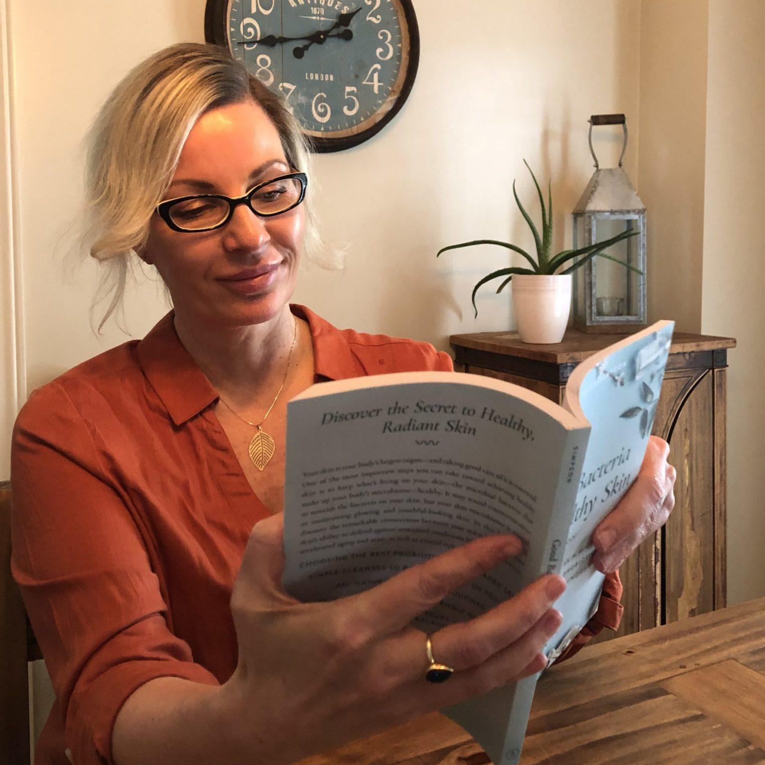 Paula seating, reading Good Bacteria for Healthy Skin.