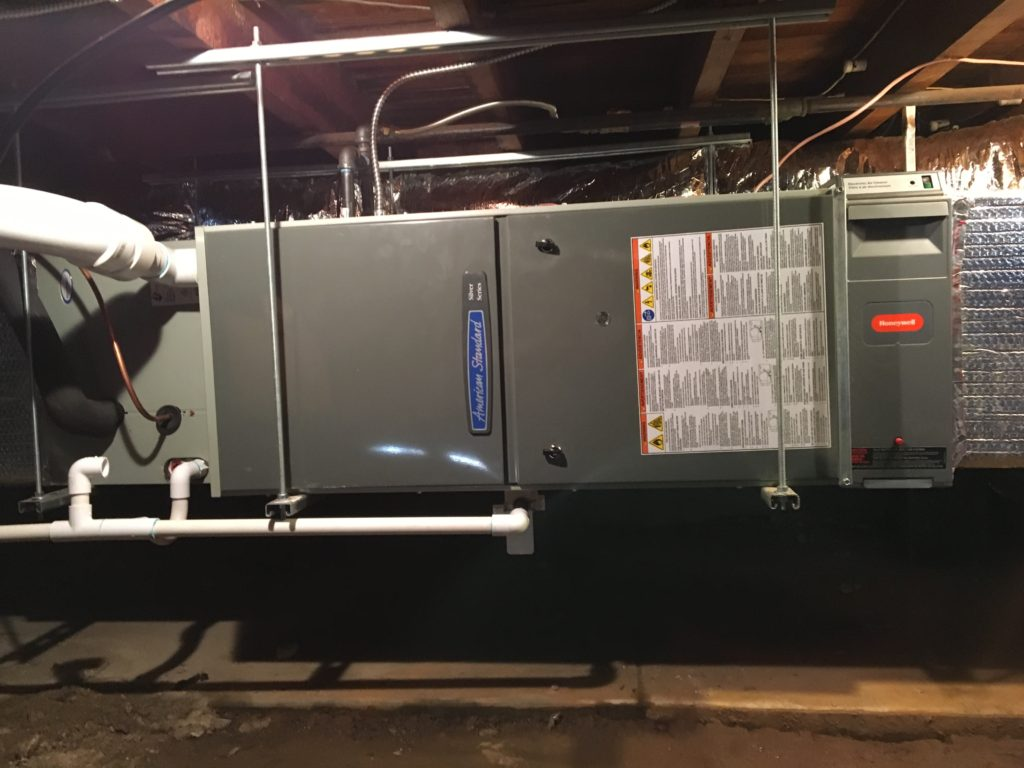Original floor furnaces make way for new American Standard high efficiency heating and cooling, with dishwasher-safe electronic air cleaner; comfort, convenience, healthy climate, AND instant property value!