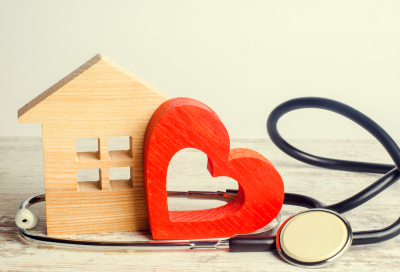 blocks shaped as heart and home with stethoscope