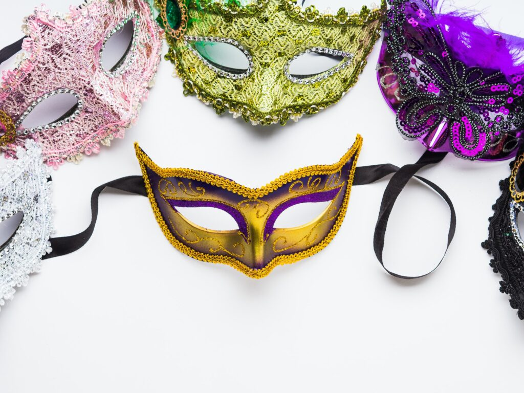 Colorful carnival masks on white background