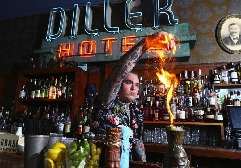 Justin Wojslaw (cq) in action as he mixes up a classic Zombie tiki drink behind the bar at The Diller Room in downtown Seattle. The bar and restaurant resides in the 130-year-old Diller Hotel building.   HAPPY HOUR - THE DILLER ROOM - TIKI DRINKS - 147370 - 052315