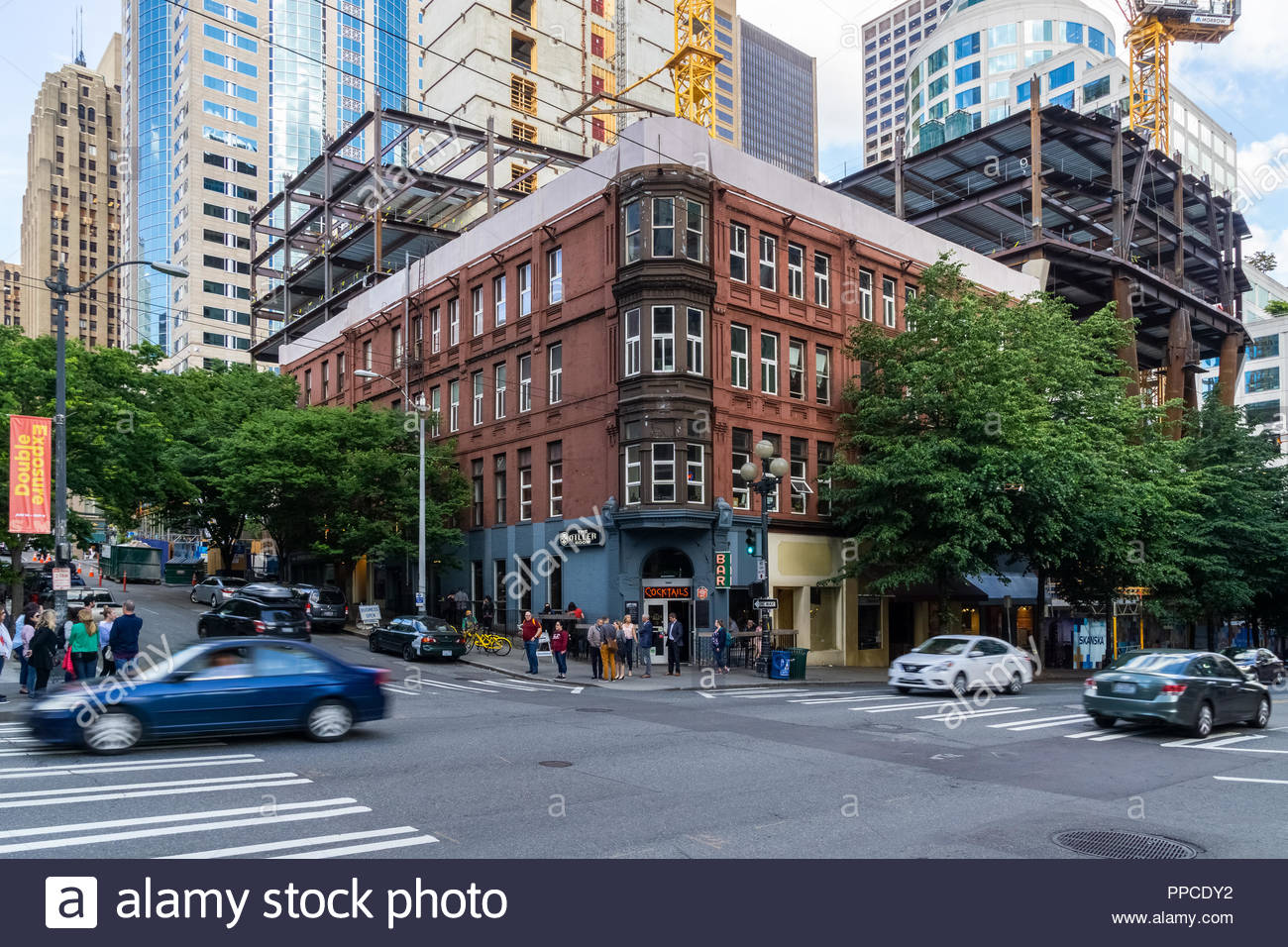 historic-brick-building-of-the-former-diller-hotel-located-on-1st-avenue-in-downtown-seattle-with-construction-site-of-the-skanska-2u-skyscraper-usa-PPCD
