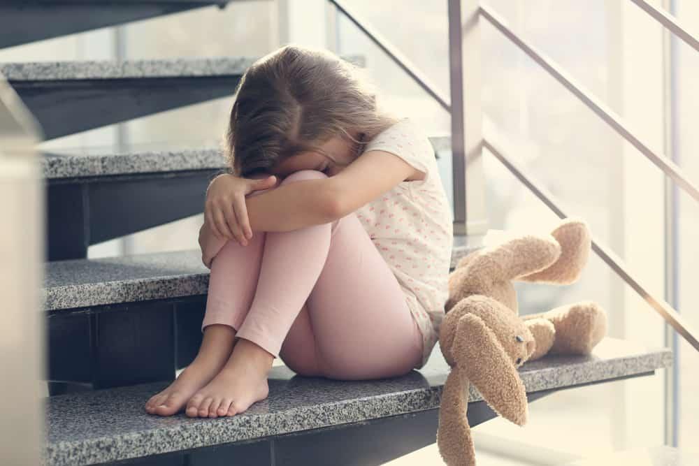 Sad,Little,Girl,Sitting,On,Stairs
