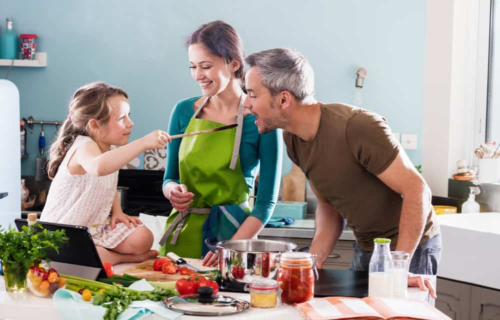 Dad,,Mom,And,Their,Little,Daughter,Cooking,Bolognese,Sauce,For