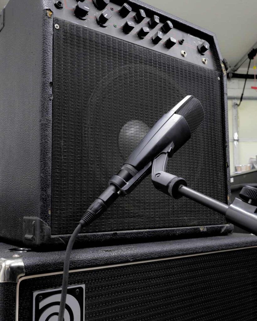 A Sennheiser MD421 with a MicLock clip arm recording an amplifier.