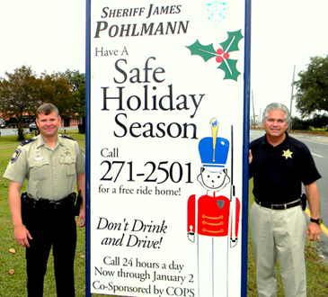 Signs telling the public about the free Holiday Ride Home program will be put up around St. Bernard Parish.  Shown at one last year is Sheriff James Pohlmann, at right, with Lt. Brent Bourgeois of the Traffic Division.