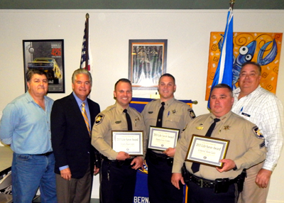 Three St. Bernard Parish sheriff's deputies received the Kiwanis Club Life-Saver Award on Jan. 27 for saving a two year-old boy who was unresponsive after falling into a home pool in Arabi on Jan. 4. Shown are, from left, Sam Catalanotto of the Kiwanis Club, Sheriff James Pohlmann, award winners Deputies Ryan Lopez and Lance Kramer, Cpl. Shane Lulei and Mitch Perkins, president of the club.