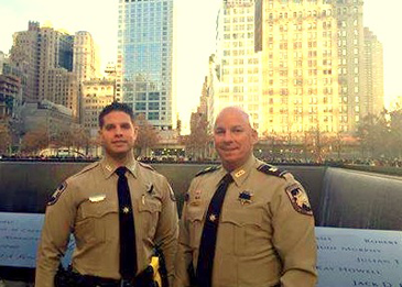 St. Bernard sheriff's deputies Carlo Cacioppo. left, and Capt. Ronnie Martin at the 911 Memorial in New York City during their trip to the funeral of a slain police officer.