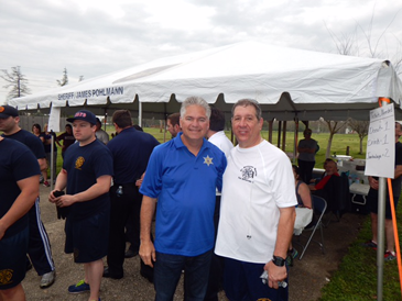 Sheriff James Pohlmann and Fire Chief Thomas Stone before the tug of war.